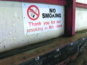 No smoking sign and benches in the Main Stand