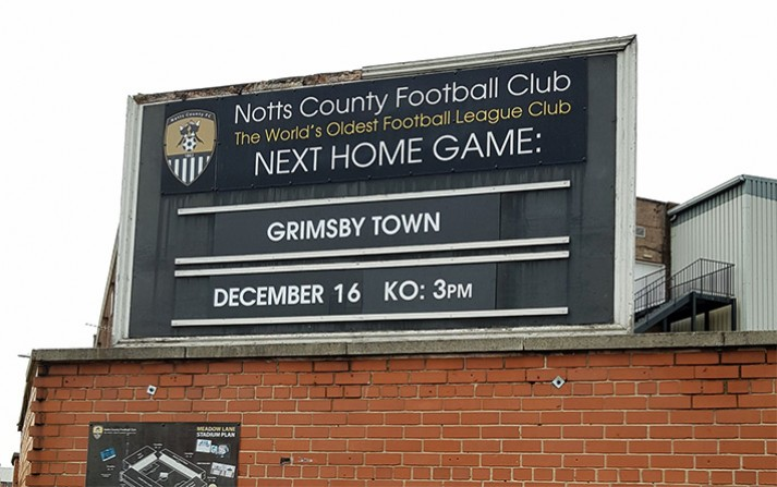 'Next home game' sign at Meadow Lane announcing the match
